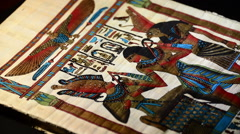 Egyptian papyrus with pharaohs and hieroglyphics representation of turning Stock Footage