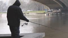 Fisherman under the Gazella bridge, Danube river Stock Footage