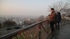 Man Watches Sun Rise Over Paris, France - As Seen From Montmartre - stock footage