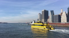 NEW YORK CITY – CIRCA OCTOBER, 2015: New York City Water Taxi with NYC skyline. - stock footage