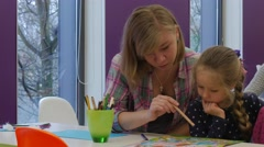 Blonde Girl Reading With Kid Children's Day Opole Poland Library Kid Turns the Stock Footage