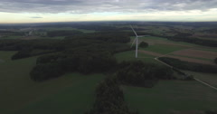 Drone footage of wind turbine turning on farm, Wuerzburg, Bayern, Germany - stock footage