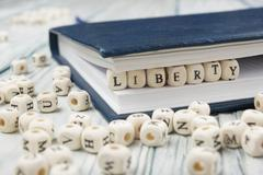 The word Liberty written wood block. Wooden ABC Stock Photos
