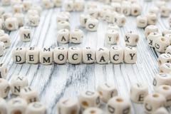 Democracy word written wood block. Wooden ABC Stock Photos