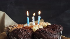 tasty birthday cupcake with candle, on grey background - stock footage