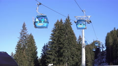 Pov shot of a gondola lift taking skiers up in the mountains Stock Footage