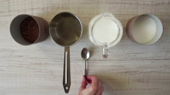 Cooking cocoa recipe top view - stock footage