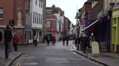 Canterbury England town center business shoppers 4K. Stock Footage