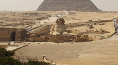 Pan Up -  Great Pyramids & Sphinx Daytime at Giza - Egypt - stock footage