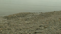 Shore-Beach-Curved bay-Beach stones-Pebbles-Pebble stones-Gentle waves-Med - stock footage
