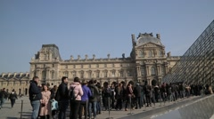 Que outside the Louvre Pyramid (Pyramide du Louvre) - Paris, France Stock Footage