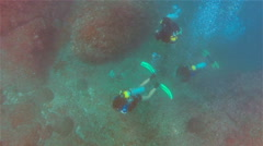 Divers, Three, Underwater, Air Bubbles in Lens Stock Footage
