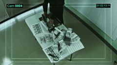 Criminal man in a clandestine laboratory cuts counterfeit money. CCTV record. Stock Footage