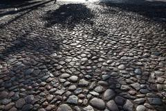 Abstract background of cobble stone road - stock photo
