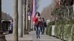 Locals walk down Avenue des Champs-Élysées - Paris, France Stock Footage