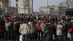 Crowd of Tourists watch busker near Arc De Triomphe. Paris, France Stock Footage