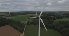 Drone film of wind turbines on field against cloudy sky, Wuerzburg, Bayern, - stock footage