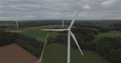 Drone film of wind turbines on field against cloudy sky, Wuerzburg, Bayern, Stock Footage