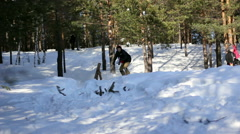 Snowboarding in forestry mountain - stock footage