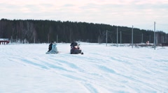 Couple in warm clothing sledding on snow Stock Footage