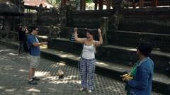 People feeding monkey in Ubud Monkey Forest in Bali, super slow motion 120fps - stock footage