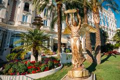 Ronze statue of an angel with a palm branch in Cannes, France Stock Photos