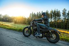 Motorcyclist riding  chopper on a road - stock photo