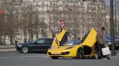 Yellow Sports Car in Paris, France Stock Footage