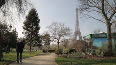 Stock Video Footage of The Eiffel Tower (Tour Eiffel) from Champ de Mars - Paris, France