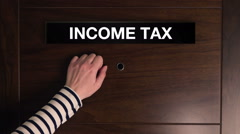 Female hand knocking at income tax office door Arkistovideo