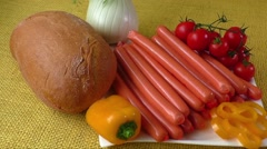 Close up of raw frankfurter sausages on white plate - stock footage
