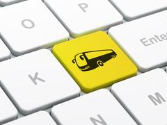 Travel concept: Bus on computer keyboard background Stock Illustration
