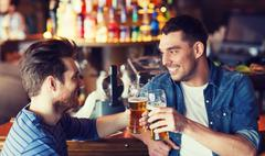 happy male friends drinking beer at bar or pub - stock photo