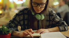 Girl doing homework and using calculator on smartphone, steadycam shot Stock Footage