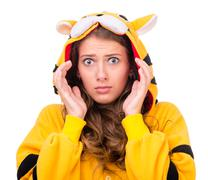 scared young woman dressed as a tiger - stock photo