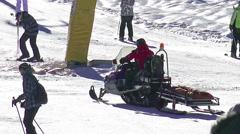 Snow mobile first aid emergency help service rides to rescue skier - stock footage
