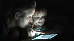 Mather and daughter enjoying a movie on tablet Stock Footage