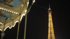 Le Carousel and The Eiffel Tower at Night - Paris, France Stock Footage