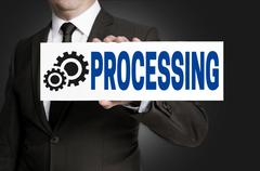 Processing only sign is held by businessman Stock Photos