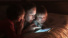 Mother and two children looking at tablet Stock Footage