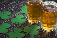 Shamrock clover and beer -symbol of St Patrick's Day Stock Photos