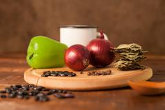 Onion, green paprika and grains Stock Photos