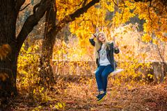 Girl and leaves all around - stock photo