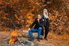 Fire and daring couple - stock photo
