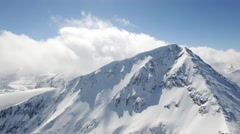 Aerial Flight Over Around Snowy Peak Beautiful Blue Sky Clouds Epic Adventure - stock footage