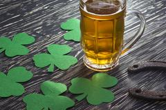 Shamrock clover, horseshoe, beer -symbol of St Patrick's Day Stock Photos