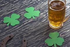 Shamrock clover, horseshoe, beer -symbol of St Patrick's Day - stock photo