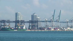 Pan shows Port of Miami as seen from Brickell Bay Drive at Point View. Stock Footage