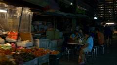 City night street food market cafe walking view 4k bangkok thailand Stock Footage
