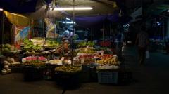 Night illuminated street food fruit market walking view 4k bangkok thailand Stock Footage
